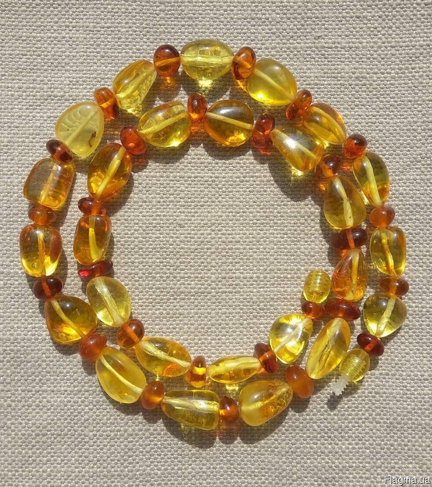 Яркие янтарные бусы из натурального полированного янтаря